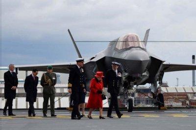 Queen Elizabeth visits namesake aircraft carrier before its deployment