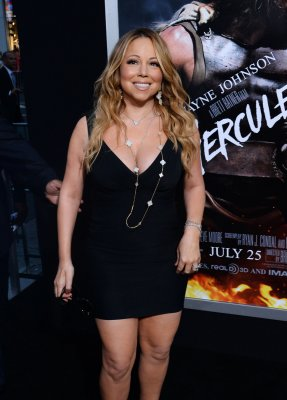 Mariah Carey leaning on Brett Ratner after Nick Cannon split