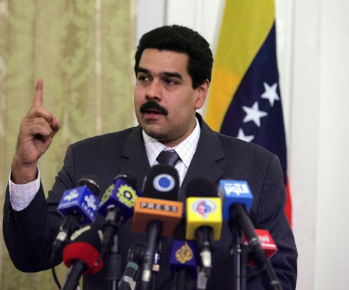 Venezuelan woman throws mango at president, gets apartment