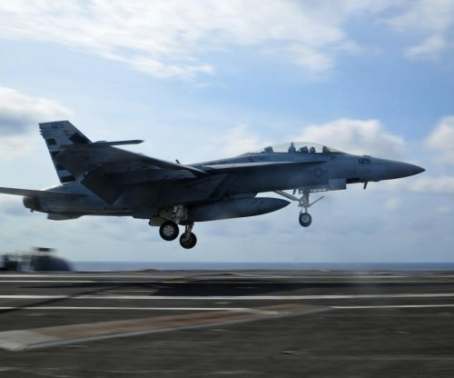 Navy tests Magic Carpet carrier landing technology