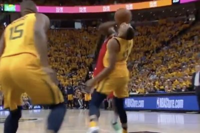 Jazz's Dante Exum fouls Rockets' James Harden with his face
