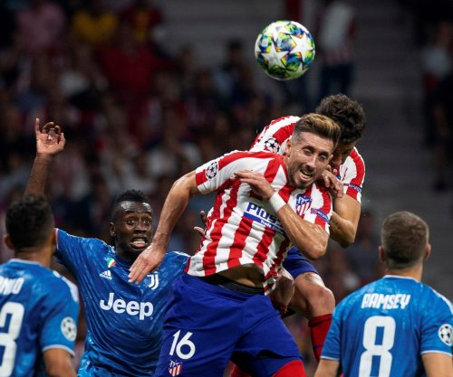 Champions League soccer: Atletico ties Juventus on 90th minute header