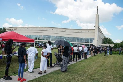 Thousands attend public viewing memorial service for George Floyd in Houston