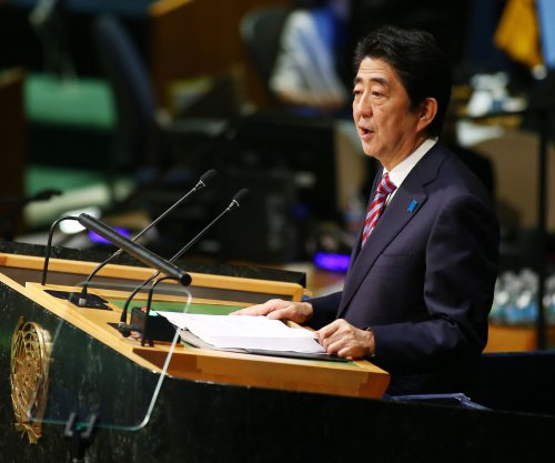 Japan's Abe calls for summit with Putin over Pacific islands