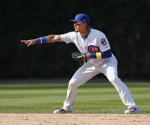 Chicago Cubs SS Javier Baez leaves game with injury