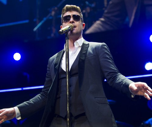 Robin Thicke, Pharrell to pay $7.3 million for copying Marvin Gaye song in 'Blurred Lines'