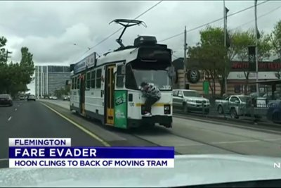 Fare-dodging teen clings to back of moving tram