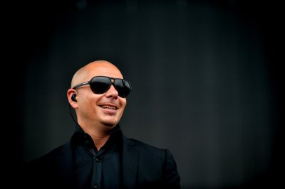 Pitbull discusses his tight, white World Cup pants, plays beer pong with Jimmy Fallon