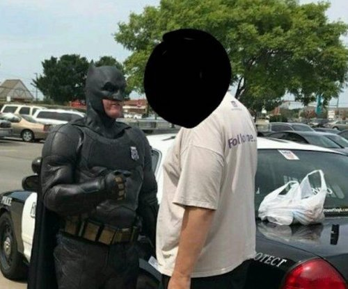 Police officer dressed as Batman arrests shoplifter at Walmart