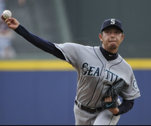 Hisashi Iwakuma fails Los Angeles Dodgers' physical, re-signs with Mariners