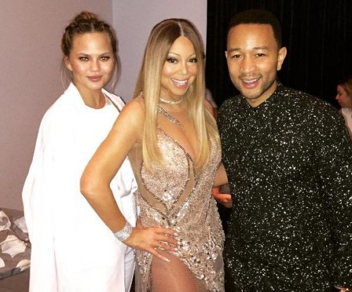 Chrissy Teigen caught cheering loudly as John Legend joins Mariah Carey onstage