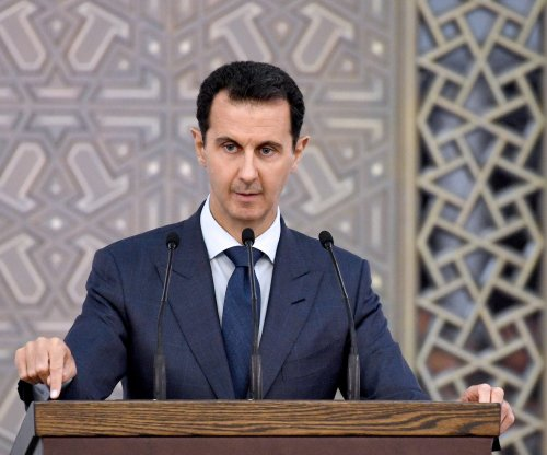 Syria's al-Assad praises Russia, Iran for help; rocket kills 5 at fair