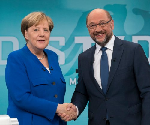 Turkey blasts Germay's Merkel, Schulz on threat to end EU bid