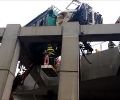 Israeli boy dangles from bridge after truck overturns