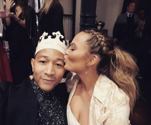 Chrissy Teigen and John Legend celebrate at baby shower