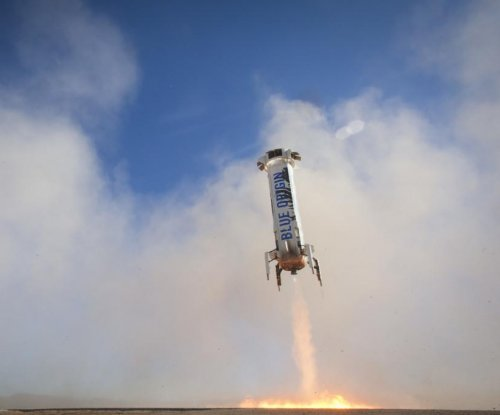 Blue Origin's reusable rocket lands upright for third time