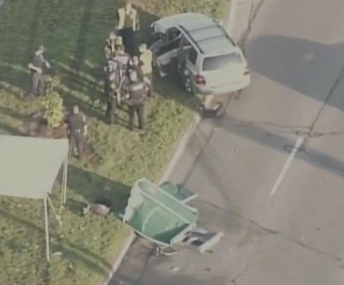 Car crashes into portable toilet in Detroit