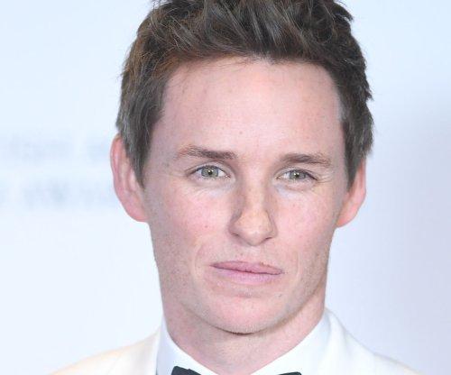 Tom Hiddleston recalls appearing in school play with Eddie Redmayne