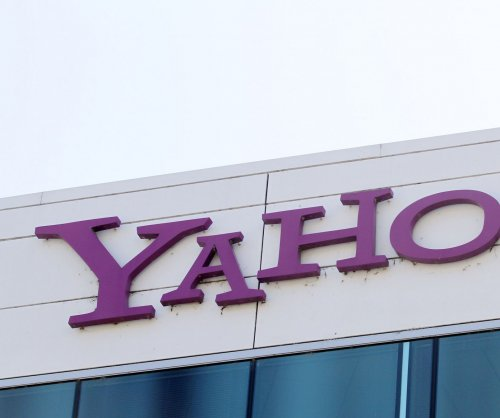 Verizon cuts $350M from price to acquire Yahoo