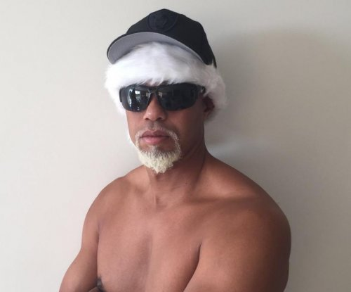 Tiger Woods introduces 'Mac Daddy' Santa Claus in new photo