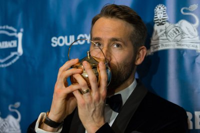 Ryan Reynolds receives his award for Hasty Pudding Man of the Year