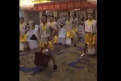 Kung Fu students dangle heavy wooden boxes from genitals