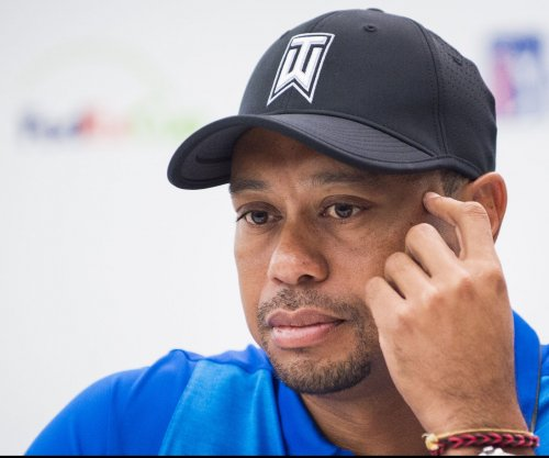 Police: Tiger Woods was asleep in his car when arrested