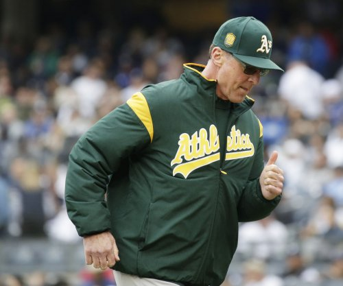 A's aim to shut down improving Royals