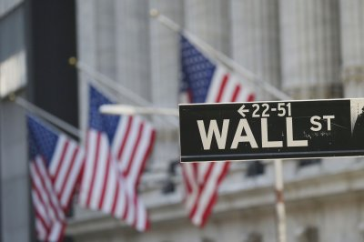 All three major U.S. indexes hit record highs amid tech rally, stimulus signing