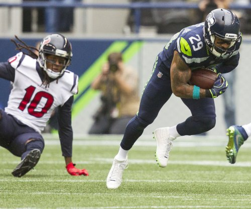 Seattle GM believes Thomas wants to stay