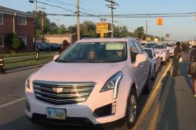Over 100 pink Cadillacs line the streets of Detroit in honor of Aretha Franklin