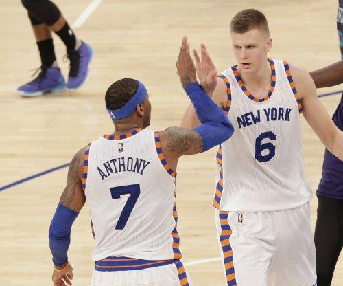 Carmelo Anthony sets tone, New York Knicks breeze past Chicago Bulls