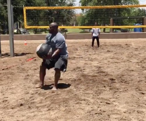James Harrison plays beach volleyball with medicine ball