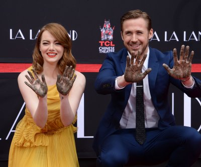Emma Stone and Ryan Gosling add their hands and feet to the TCL Theatre