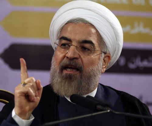 Iranian president vows to hold up Tehran's end of deal