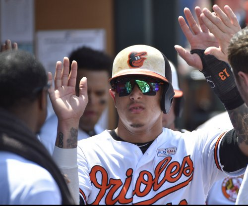 Orioles face Rangers, with Machado likely on way out