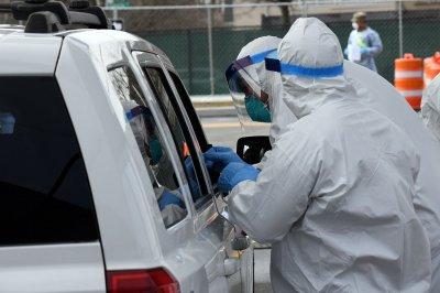 Authorities urge limits on coronavirus testing to conserve equipment