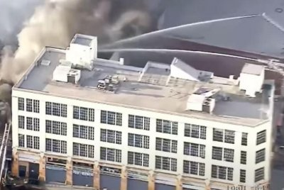 Eleven firefighters injured in structure fire in downtown Los Angeles