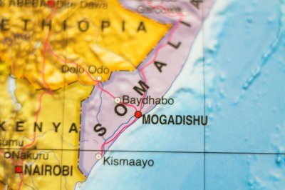 13 killed in twin car bombings near police headquarters in Somalia