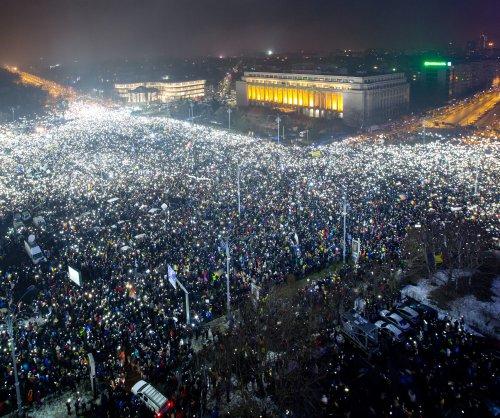 Romania's ruling government survives no-confidence vote