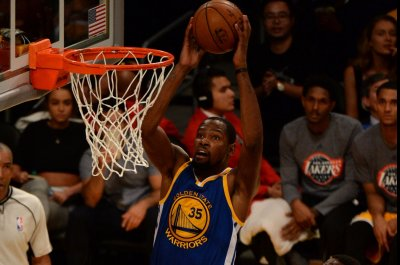 Kevin Durant, Golden State Warriors slog past Miami Heat