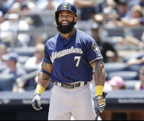 Thames adjusting to left field as Brewers host Cardinals