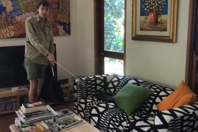 Family finds massive python lounging on their sofa