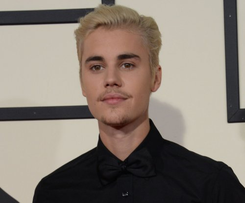 Justin Bieber brings Selena Gomez as date to dad's wedding