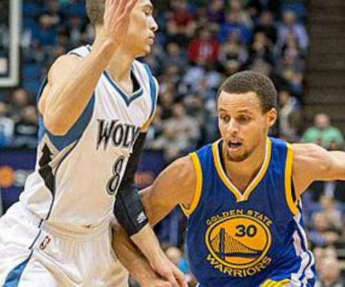 Curry, Golden State Warriors slip past Minnesota Timberwolves