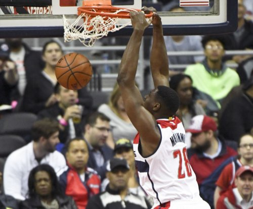 Washington Wizards C Ian Mahinmi to miss at least two more games with strained left calf