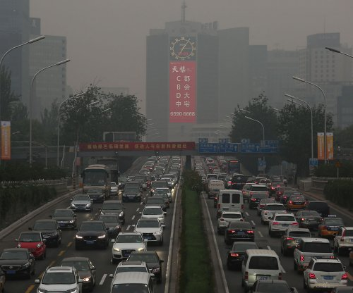Beijing starts using special license plates for green vehicles