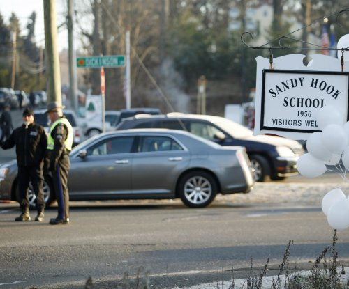State police report: Civilians stepped on evidence at Sandy Hook