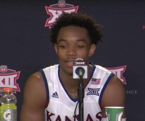 No. 1 Kansas hangs on to defeat Baylor