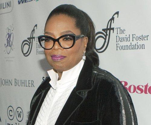 Oprah Winfrey welcomes DJ Khaled to Weight Watchers team